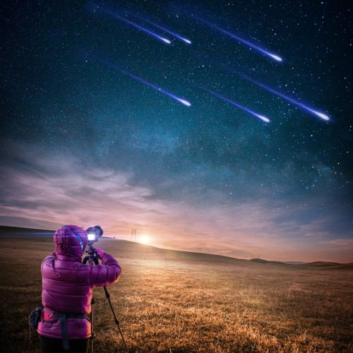 person taking pictures of stars