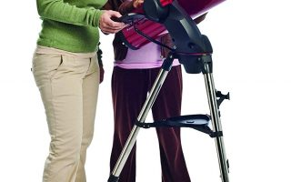 two women checking a Celestron skyprodigy 130 telescope