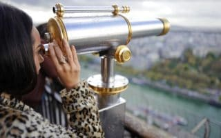 Lady using telescope to view